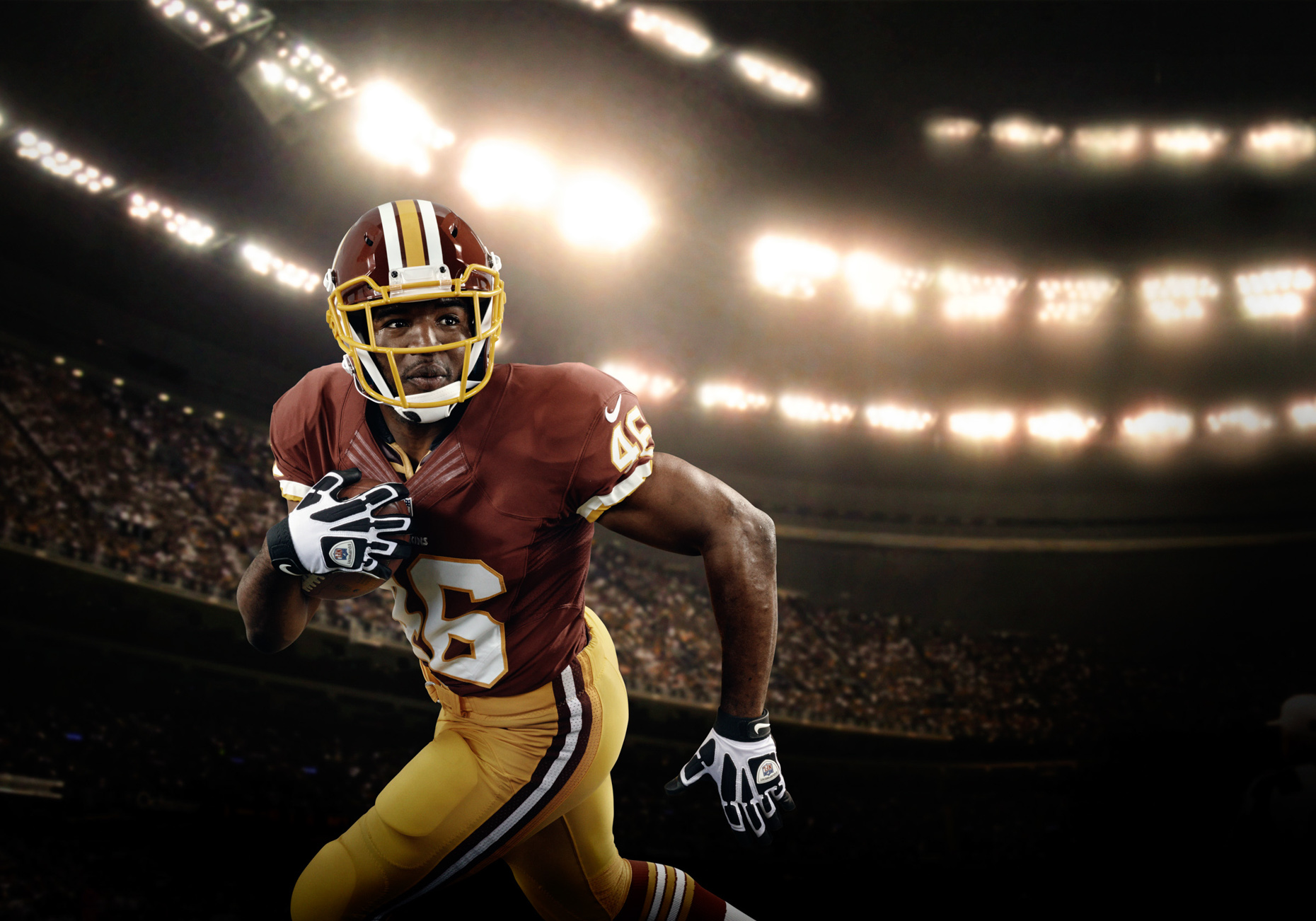Washington Redskin Alfred Morris  for Verizon NFL rushing past the camera in a packed stadium