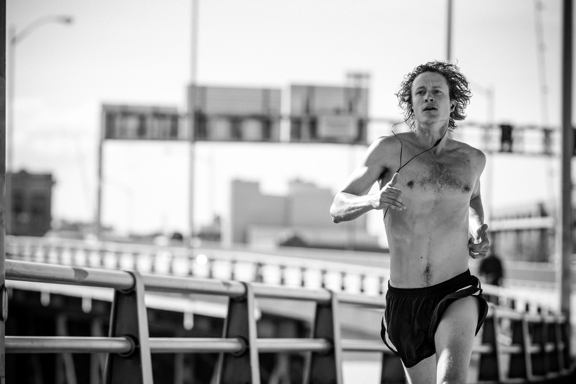 urban running athlete in downtown Portland by fitness photographer Andy Batt