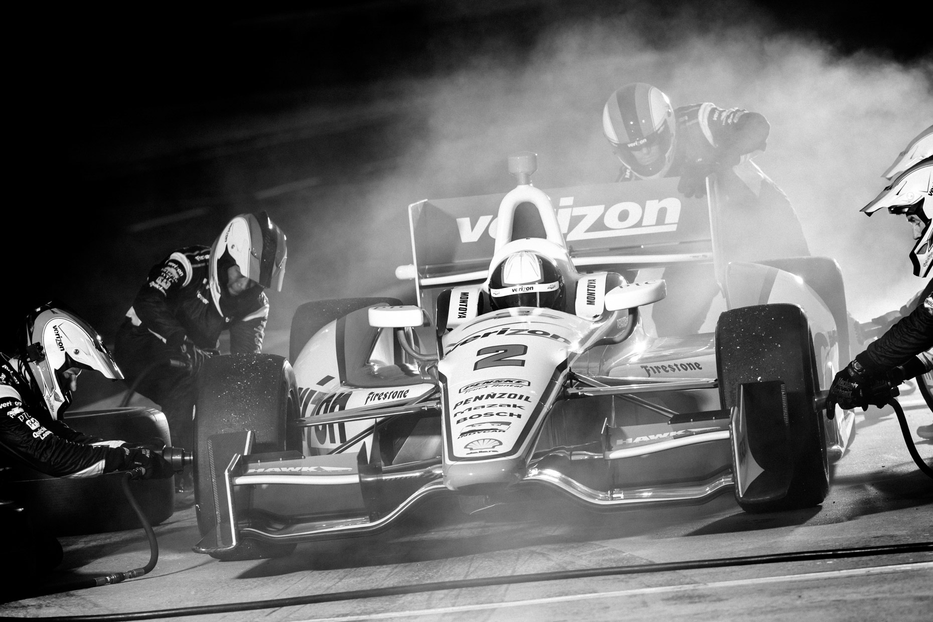 Dramatic pit stop action photographed by dramatic sport photographer Andy Batt