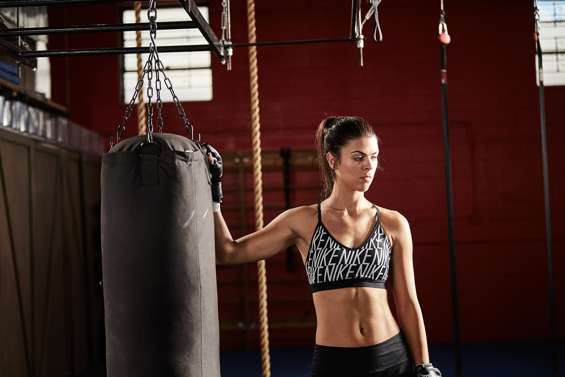 athletic model Victoria Petrosky boxing in a crossFit training gym