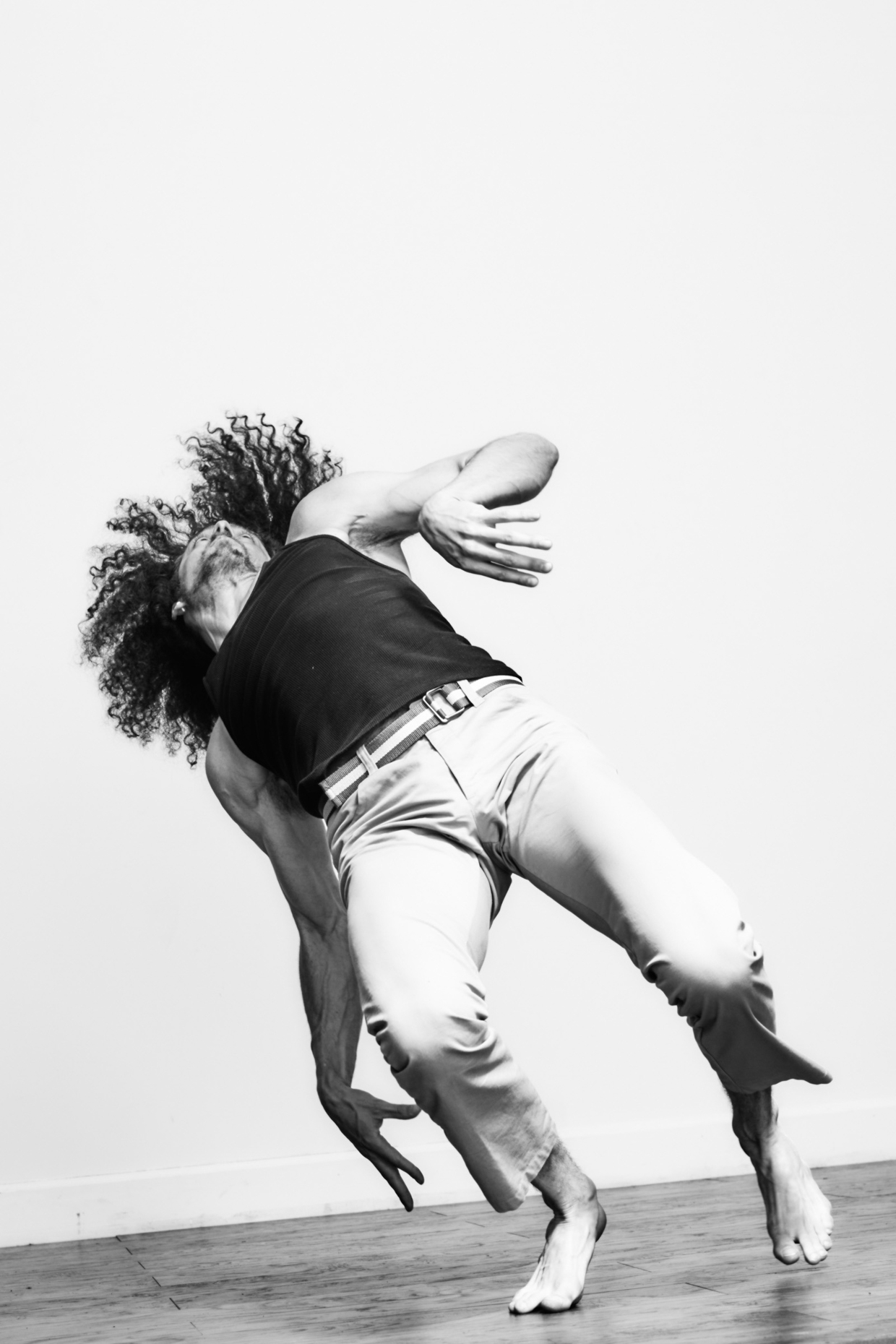 Modern dancer Michael Galen strikes a pose for dramatic dance photographer Andy Batt