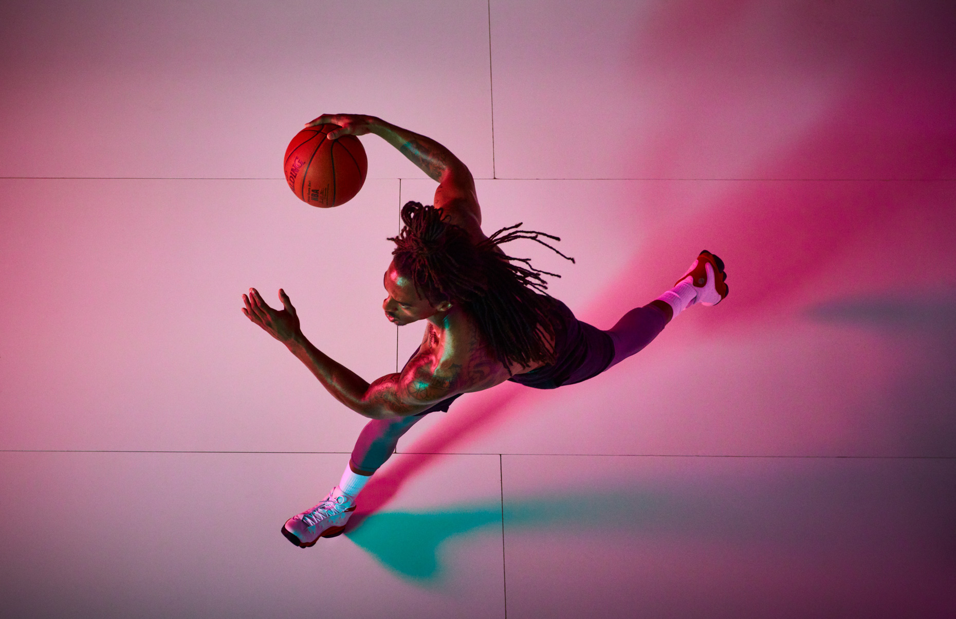 Professional sport athlete Xavier Taylor, of Sports and Lifestle Unlimited, plays basketball