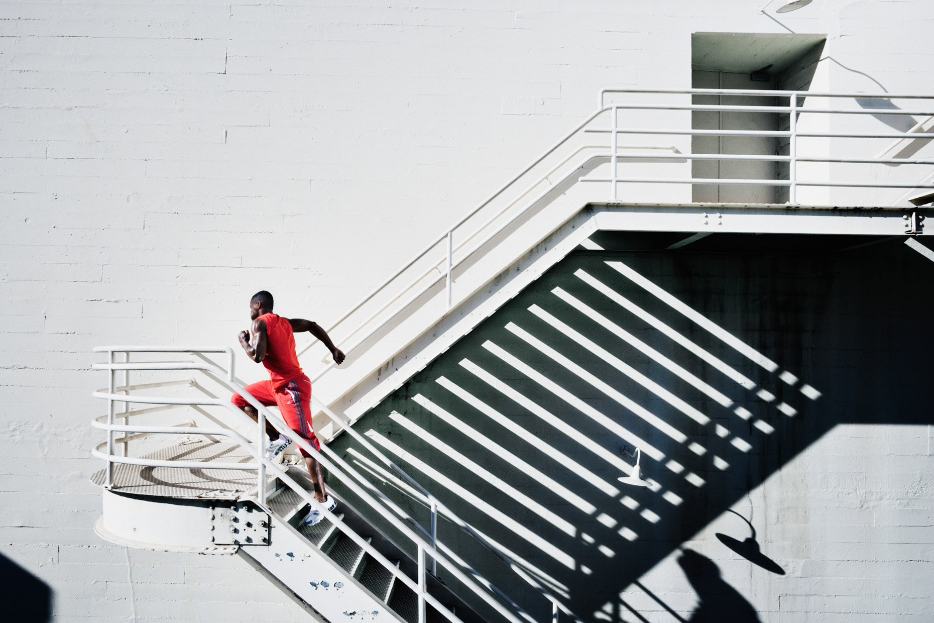 Urban running and training in San Francisco for adidas by dramatic fitness photographer Andy Batt